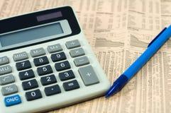 Finance. Instruments, pencil, calculator, newspaper Stock Photo