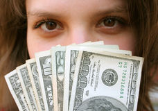 Finance. Photo of a confident young business woman holding currency notes Stock Photo