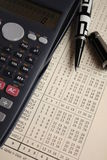 Finance. Instruments: pen, calculator and newspaper Stock Photos