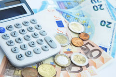 Finance and accounting concept.Money coins and banknotes with ca Stock Photos