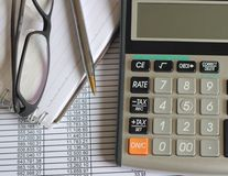 Finance accounts tax calculator. Accounts with notebook, pen, glasses, tax calculator on financial statement and balance sheets Stock Images