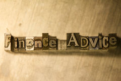Finance advice - Metal letterpress lettering sign. Lead metal 'Finance advice' typography text on wooden background Stock Photography