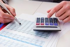 The finance analyst looking and financial reports stock image