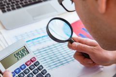 The finance analyst looking and financial reports stock photography