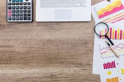 Finance analyst working place with magnifying glass. Finance analyst working place with magnifying glass royalty free stock images
