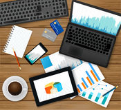 Finance analytic, accounting or businessmen workplace.Top view -laptop with financial graph on screen, tablet, documents Royalty Free Stock Image