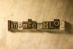 Finance blog - Metal letterpress lettering sign. Lead metal 'Finance blog' typography text on wooden background Stock Images