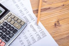 Pencil and Calculator on Earning Report. Finance and business concept, pencil and calculator on earning report Royalty Free Stock Image