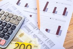 Euro Banknotes with Pencil and Calculator on Earning Report. Finance and business concept, two hundred euro banknotes with pencil and calculator on graph chart Royalty Free Stock Photo