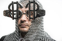 Finance, businessman with medieval executioner in metal and silv Royalty Free Stock Image