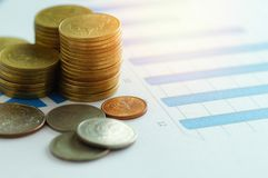 Finance capital banking and accounting concept,money coins  on p. Aper graph Royalty Free Stock Photography