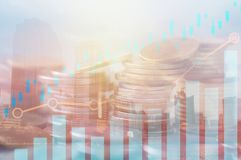 Finance, capital banking and investment concept, Double exporsur. E stacked of coins and night city with graph Stock Photos