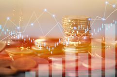 Finance, capital banking and investment concept, Double exporsur. E stacked of coins and night city with graph Stock Images