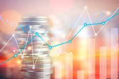 Finance, capital banking and investment concept, Double exporsur. E stacked of coins and night city with graph Royalty Free Stock Images