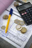Finance concept. Calculator, coins and a pen of the асcountant Stock Photo