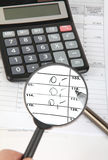 Finance concept. Magnifying glass over the tax form or finance balance stock images