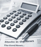 Finance concept. The calculator and the pen lie on the newspaper Royalty Free Stock Photography