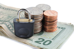 Finance concept. Padlock with cents and bank-notes isolated Stock Photography