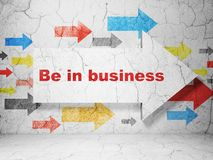 Finance concept: arrow with Be in business on grunge wall background Royalty Free Stock Photo