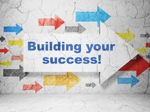 Finance concept: arrow with Building your Success! on grunge wall background. Finance concept:  arrow with Building your Success! on grunge textured concrete Stock Photo
