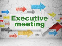 Finance concept: arrow with Executive Meeting on grunge wall background. Finance concept:  arrow with Executive Meeting on grunge textured concrete wall Royalty Free Stock Photo