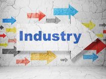 Finance concept: arrow with Industry on grunge wall background. Finance concept:  arrow with Industry on grunge textured concrete wall background, 3D rendering Stock Photo