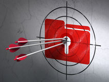 Finance concept: arrows in Folder With Keyhole target on wall Stock Photography