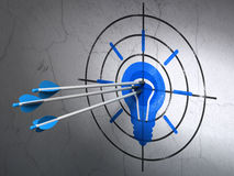 Finance concept: arrows in Light Bulb target on. Success finance concept: arrows hitting the center of Blue Light Bulb target on wall background, 3d render Stock Photography