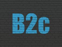 Finance concept: B2c on wall background. Finance concept: Painted blue text B2c on Black Brick wall background Royalty Free Stock Image