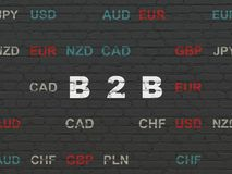 Finance concept: B2b on wall background. Finance concept: Painted white text B2b on Black Brick wall background with Currency Royalty Free Stock Photography
