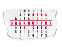 Finance concept: Bankruptcy in Crossword Puzzle. Finance concept: Painted red word Bankruptcy in solving Crossword Puzzle on Torn Paper background Stock Photography