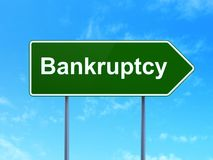 Finance concept: Bankruptcy on road sign background. Finance concept: Bankruptcy on green road highway sign, clear blue sky background, 3D rendering Royalty Free Stock Image