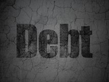 Finance concept: Debt on grunge wall background. Finance concept: Black Debt on grunge textured concrete wall background Stock Photos