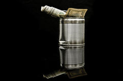 Finance concept. Blank tin box with dollar. Royalty Free Stock Images
