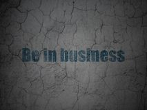 Finance concept: Be in business on grunge wall background. Finance concept: Blue Be in business on grunge textured concrete wall background Royalty Free Stock Image