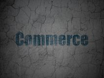Finance concept: Commerce on grunge wall background. Finance concept: Blue Commerce on grunge textured concrete wall background Stock Photos
