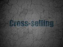 Finance concept: Cross-Selling on grunge wall background. Finance concept: Blue Cross-Selling on grunge textured concrete wall background Stock Photography