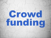 Finance concept: Crowd Funding on wall background. Finance concept: Blue Crowd Funding on textured concrete wall background Royalty Free Stock Photography