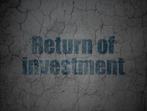 Finance concept: Return of Investment on grunge wall background. Finance concept: Blue Return of Investment on grunge textured concrete wall background Stock Images