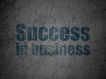 Finance concept: Success In business on grunge wall background. Finance concept: Blue Success In business on grunge textured concrete wall background Stock Photo