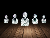 Finance concept:  business man icon in grunge dark Stock Image