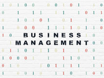 Finance concept: Business Management on wall. Finance concept: Painted black text Business Management on White Brick wall background with Binary Code, 3d render Royalty Free Stock Image