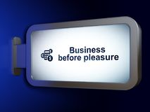 Finance concept: Business Before pleasure and Calculator on billboard background. Finance concept: Business Before pleasure and Calculator on advertising Royalty Free Stock Photos