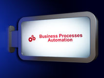 Finance concept: Business Processes Automation and Gears on billboard background royalty free stock images