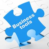 Finance concept: Business Tools on puzzle background. Finance concept: Business Tools on Blue puzzle pieces background, 3D rendering Royalty Free Stock Images