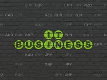 Finance concept: IT Business on wall background. Finance concept: Painted green text IT Business on Black Brick wall background with Currency Royalty Free Stock Photography