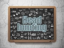 Finance concept: Head Hunting on School board background. Finance concept: Chalk Blue text Head Hunting on School board background with  Hand Drawn Business Stock Image