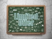 Finance concept: Limited Offer on School board background. Finance concept: Chalk Blue text Limited Offer on School board background with  Hand Drawn Business Royalty Free Stock Photo