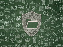 Finance concept: Folder With Shield on School board background. Finance concept: Chalk Pink Folder With Shield icon on School board background with  Hand Drawn Royalty Free Stock Photography