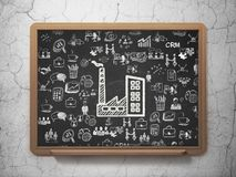Finance concept: Industry Building on School board background. Finance concept: Chalk White Industry Building icon on School board background with  Hand Drawn Stock Image